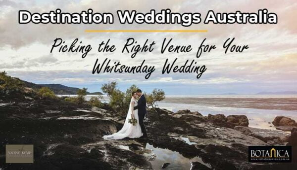 a newly wedded couple in the middle of shoreline rocks with a banner text of destination weddings australia - whitsunday wedding at Villa Botanica